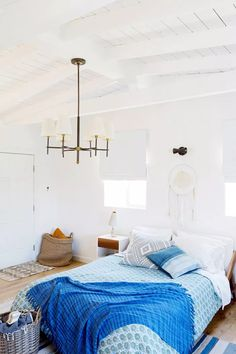 """When furnishing your bedroom, one tip that feng shui expert Laura Cerrano shares is to choose items you love to optimize the energy. """"Accent pillows, a throw blanket, and a comforter can all help enhance the energy through subtle colors, patterns, and designs,"""" she suggests."""