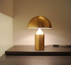 Atollo gold table lamp by Vico Magistretti for Oluce
