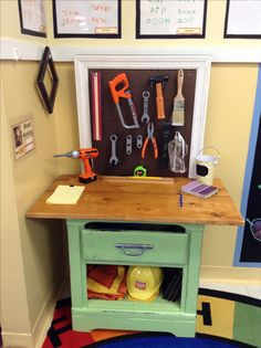 Children's woodworking tool bench. I used a thrift store nightstand, spray painted and distressed it then added a table top, pegboard back and drilled holes for golf tee nails to be hammered into.