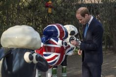 """Prince William: China Day 1: The Duke of Cambridge painted in front of the British Embassy, a sculpture of """"Shaun the Sheep""""."""