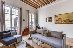 Apartment in Paris, France. In the heart of a pedestrian friendly area of Paris, enjoy the modern comfort and the charm of this lovely apartment, completely renovated and featured. Special ! French ceilings with height of 3.50 m and exposed beams.   1st floor, no lift.  Love...