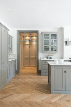 -Design Trend: Herringbone Wood Floors herringbone wood floor with gray shaker kitchen cabinets Grey Shaker Kitchen, Shaker Kitchen Cabinets, Kitchen Cabinet Design, Kitchen Interior, Kitchen Decor, Kitchen Ideas, Kitchen Tips, Shaker Style Kitchens, Kitchen Counters