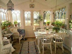 Perfect enclosed porch turned Dining Room