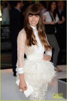 Jessica Biel. Giambattista Valli Haute Couture shirt, skirt, and feather belt. Christian Louboutin shoes. Vhernier jewels. Fendi bag.