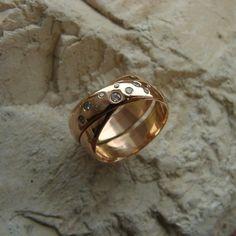 van 2 ringen een doorlopend model en een aantal briljanten