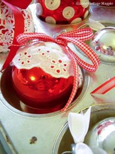 another great idea for thrift store glass ornaments! try decoupage those lacy paper doilies on them!
