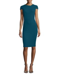 Roland Mouret double-crepe dress. Asymmetric neckline; V'd back. Cap sleeves. Seam at natural waist. Sheath silhouette. Straight hem; back vent. Full-length golden back zip. Wool; silk/spandex lining.