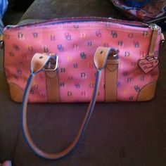 🌟REDUCED🌟Authentic Gently Used Dooney and Bourke Pink Dooney and Bourke handbag Authentic and gently used Pen mark on the lower inside of the purse shown in the pic thanks Dooney & Bourke Bags
