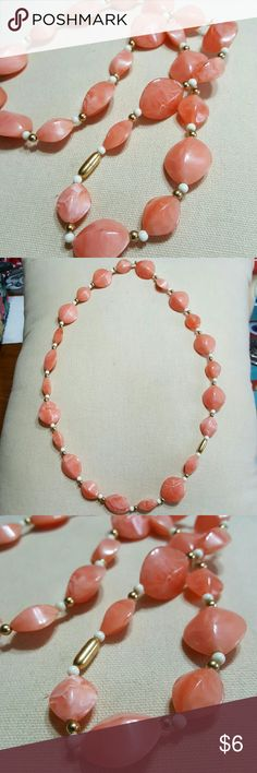 """Coral Necklace This coral colored necklace is stunning.  Full of fun coral colored beads, small white & gold beads too.  Lightweight & easy to throw on in a rush.  24"""".  Feel free to ask any questions before purchasing.   Thanks for shopping my closet! Jewelry Necklaces"""