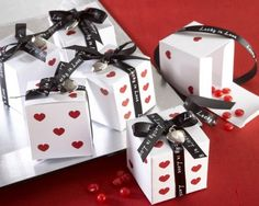 Favors - use black dots instead of hearts - maybe order ribbon that says: Hope you had a rolling good time!