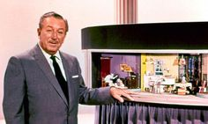 """Walt Disney with a model for the """"Carousel of Progress"""" attraction."""