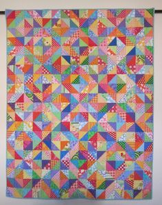 Warm/Cool scrap quilt made with HSTs.