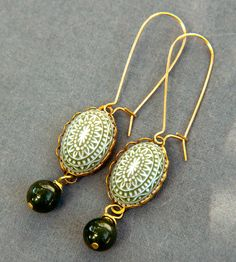 Green and white cabochons are accented with green jade drops. Intricate but not overwhelming, their style is quietly stunning.