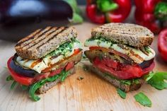 Grilled Eggplant and Roasted Pepper Sandwich, with hearty eggplant, flavorful red peppers, juicy tomatoes, smoky cheese, and a bright smear of pesto