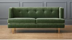 avec apartment sofa with brass legs (used for sizing of smaller sofa in front attic space)