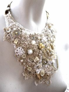 I LOVE lace. Why not make a necklace out of it with buttons and all sorts of special gems?