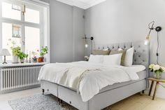Bedroom with light grey walls