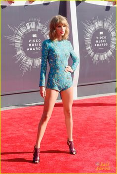 Taylor Swift  looking amazing at the MTV #VMAs2014  Red Carpet look includes : Romper—Mary Katrantzu Shoes—Elie Saab Earrings & rings—Lorraine Schwartz Gold pave bands—Ofira