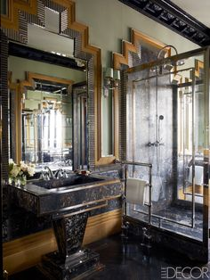 In the master bath, custom-made moldings of carved walnut, steel, and silver leaf replicate an original motif in the Art Deco apartment building. The sink is custom-made, and the towel rack and shower and sink fittings are by Devon & Devon.   - ELLEDecor.com
