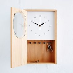 Beautifully useful. This graceful, beech wood clock can affix to a wall or hold its own on a shelf. A hidden compartment for up to five sets of keys, and a space for phones, trinkets or to-do lists, makes it a godsend for neatniks.