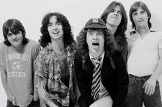 1979: Australian rock band ACDC posed in a studio in London in August - Left to right Malcolm Young, Bon Scott, Angus Young, Cliff Williams and Phil Rudd - credit: getty images