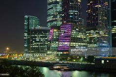 View of skyscrapers on Moscow-City ( Moscow International Business Center or Moskva-City ) at night. Located on the banks of the Moskva River (Moscow River).