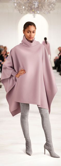 The graceful Ralph Lauren Collection Lawson cape is crafted in Italy from a double-faced wool-and-cashmere blend and features a stunning asymmetrical funnel neckline with mother-of-pearl buttons.