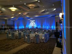 Christina and Eric's reception décor began with a beautiful ivory head table backdrop that welcomed their family and friends into their reception in the Verona Ballroom. Elegant Event Lighting Chicago shined Christina and Eric's custom monogram in the center and illuminated the backdrop with blue uplighting.