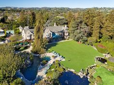 The famed Playboy Mansion in Los Angeles' Holmby Hills is for sale: all 5 acres, 29 rooms, the storied grotto, a zoo license, and Hef himself.