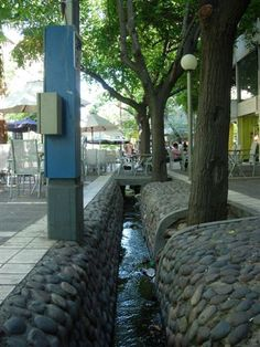 These aqueducts run thru the streets of Mendoza, Argentina.