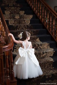 Brown and White - little girl on grand staircase