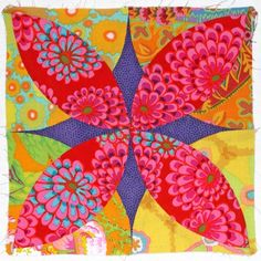 Quilt block called Alabama Beauty done in Kaffe Fassett fabrics. Stunning.