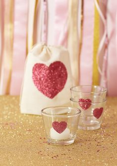 DIY glittler heart votives. Would make a cute little gift filled with candy hearts wrapped in cellophane and ribbon.