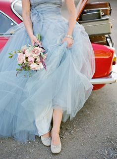 Love the soft colors of the dress and flower bouquet. Pretty Combo.