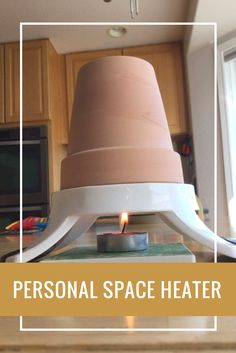 Personal Space Heater - You are going to want to grab an apple slicer and a terra cotta pot when you see this brilliant and frugal DIY project! ➟