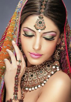 green and pink indian bride make up