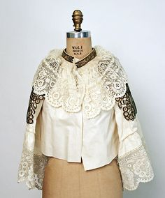 Western Slovak silver and gold embroidery.  They would wrap the thread around cardboard because it was so heavy that it would tear the fabric if embroidered the traditional way.