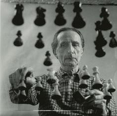 Marcel Duchamp playing chess at his 14th Street Studio in New York in 1958.   Gelatin silver print by Arnold T.Rosenberg