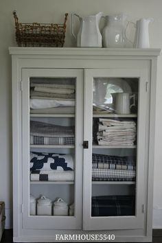 FARMHOUSE Farmhouse Friday ~ Farmhouse Storage~~~~Ironstone and quilts are a great combination~~~ Style At Home, Deco Tv, Farmhouse Storage Cabinets, Linen Cupboard, Linen Storage Cabinet, Home Fashion, Painted Furniture, Furniture Design, Furniture Storage