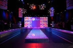 Jonathan Adler designed a custom logo for Diet Pepsi's event and used 14,000 of the beverage brand's cans to create a set that included runway and bench seating.
