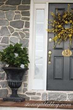 Urn with hydrangea at front door entry