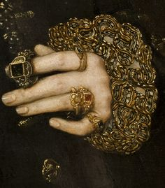 Image: a detail from Mary Nevill, Lady Dacre portrait by Hans Eworth, 1559 | Rings were worn by both the middle classes and the nobility, and were often worn on the second joint of the finger as well as the first. Larger jewels were worn as solitaires. Gold bands engraved with a motto inside were often worn as wedding rings. Signet rings were sturdy, meant for daily use and business. A nobleman's signet ring could depict the family's heraldic device.