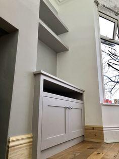 Modern style alcove cupboard with media shelf Alcove cupboard with integrated media shelf, perfect for TV's Alcove Tv Unit, Alcove Storage, Alcove Shelving, Living Room Shelves, Living Room Storage, Living Room With Fireplace, Home Living Room, Fireplace Wall, Alcove Cupboards