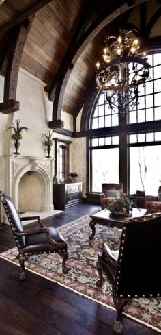 old world living room, beams, iron chandelier