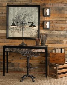 Raw and Industrial - The recycled timber wall adds warmth against the vintage map and upcycled tractor seat