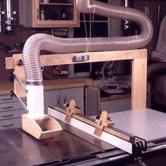 Tablesaw Dust Collector with Tablesaw Hold-Downs Woodworking Plan, Workshop & Jigs Dust Collection Dust Collector with Tablesaw Hold-Downs Woodworking Plan, Workshop & Jigs Dust Collection Woodworking Basics, Woodworking Patterns, Woodworking Workshop, Popular Woodworking, Woodworking Furniture, Woodworking Crafts, Woodworking Projects, Wood Projects, Woodworking Videos