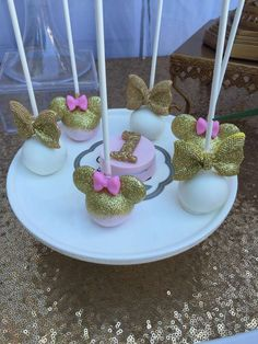 Sparkly cake pops at a gold & pink Minnie Mouse birthday party! See more party ideas at CatchMyParty.com!
