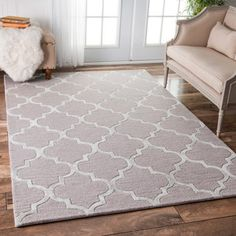 This hand-tufted wool area rug features a striking trellis pattern. This soft a plush area rug was meticulously handcrafted to create a luxurious boldness and softness under foot. Pile Height: 0.25 - More