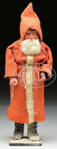 GERMAN SANTA CANDY CONTAINER. Large German figural Santa has composition hands and face with real rabbit's fur beard. Felt robe tied at waist with black crepe paper lining. Composition boots and base are covered with mica like snow decoration. Very nice facial features with high cheek bones and passive Santa face. Lower body removes at waist to reveal cardboard candy container.