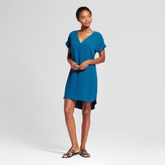 For a look you can sport during the day or at night, reach for the Short-Sleeve Crepe Dress from A New Day™. This dress comes in a simple design to add effortless radiance to your everyday style. You'll love the easy comfort of the relaxed fit and curved high-low hem — whether you keep things casual for a shopping date by wearing sneakers and a denim jacket or go a bit dressy for a night out wearing strappy heels, you'll look great and feel even better.